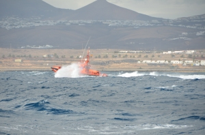 Coast Guard off to help a boat that ran ashore in big winds.